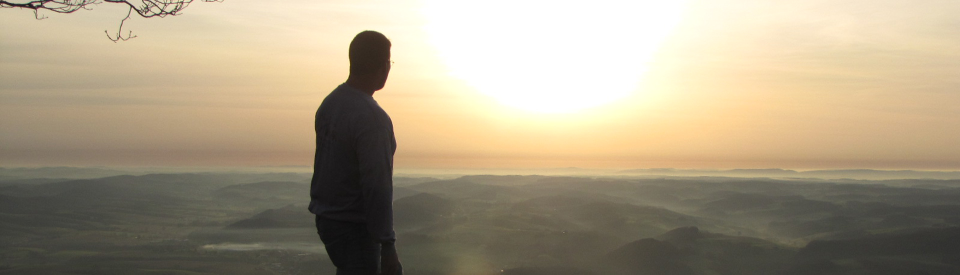 Jed Wood watching a sunrise from the Pinnacle.