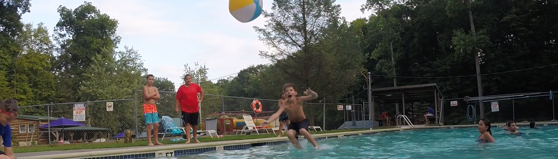Kid jumping into swimming pool.