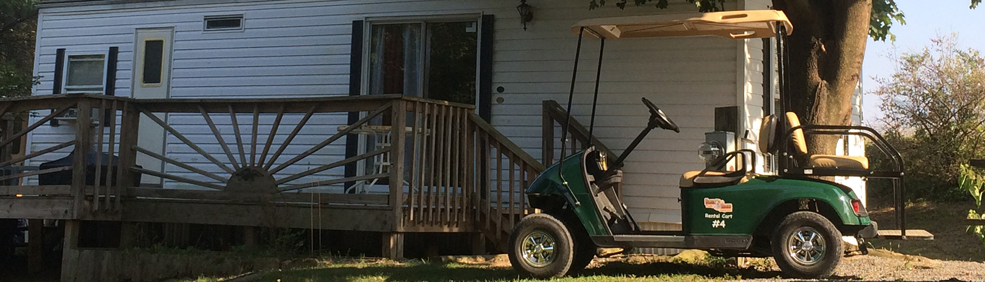 Golf cart parked in front of a cottage